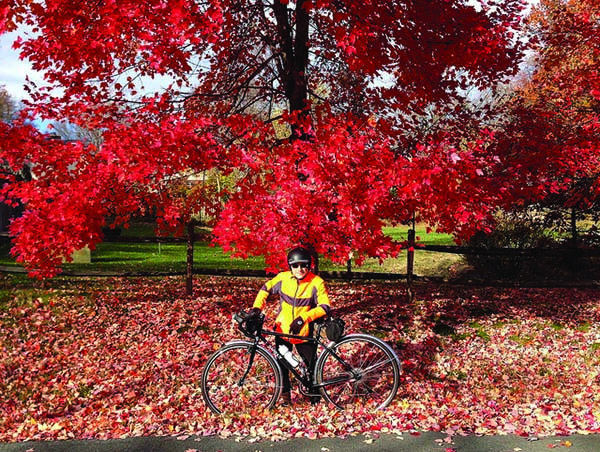 Bicycling in cool air with colorful foliage backgrouns